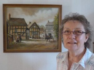 Fran Holt with her painting by Frank Paddock